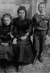 Christina Raynor, nee Collier (centre) with her sister Ellen (left) and brother Lawrence (right). Photo courtesy of the Collier family.